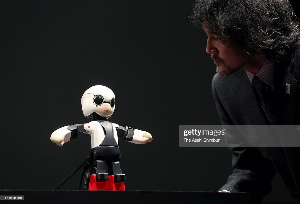 Humanoid robot 'Kirobo' chats with Toyota motor Co engineer Fuminori Kataoka during its reveiling on June 26, 2013 in Tokyo, Japan. The 34-centimeter-high, 1-kilogram humanoid robot will be sent into space in August and be a company for Japanese astronaut.