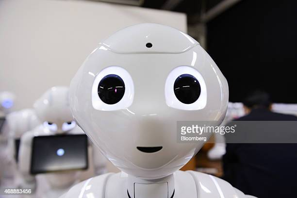 A humanoid robot named Pepper developed by SoftBank Corp's Aldebaran Robotics unit stands during a Softbank developer's workshop for students and...