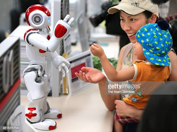Humanoid robot 'Nao' developped by French company Aldebaran interacts with customers at Bank of Tokyo Mitsubishi UFJ Osaka Chuo branch on July 21...