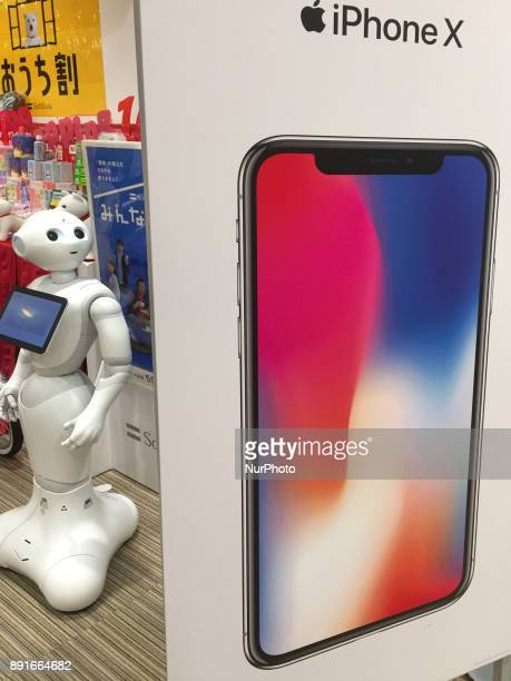 A humanoid robot quotPepperquot looks at Apple's new iPhone X at Store in Tokyo shopping district Japan December 13 2017