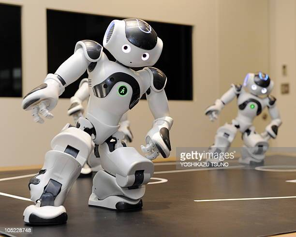 """Humanoid robots called """"Nao"""" from the French robotics venture Aldebaran demonstrate their skills during a display at the French Embassy in Tokyo on..."""