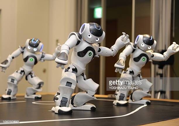 Humanoid robots called Nao from the French robotics venture Aldebaran demonstrate their skills during a display at the French Embassy in Tokyo on...