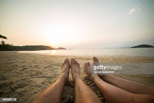human's feet relaxing on a tropical beach - pretty asian feet stock photos and pictures