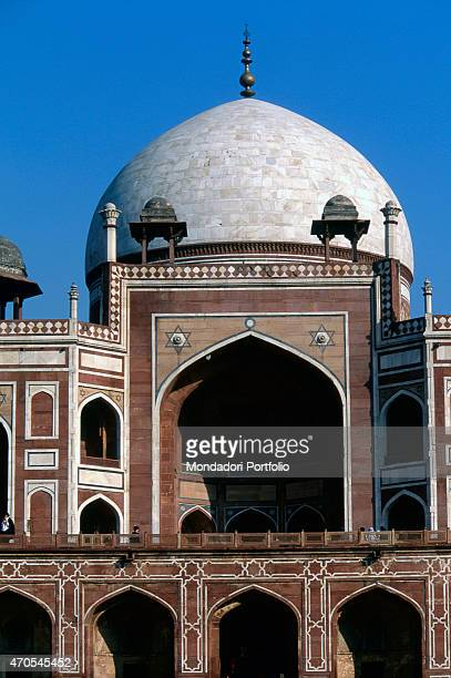 'Humayun's Tomb by Mughal craftsmen 15651572 16th Century red sandstone and white marble India Delhi Charbagh Garden Detail The central dome of the...