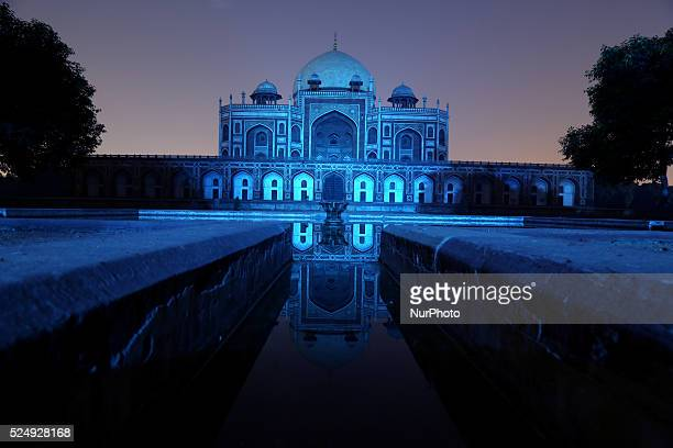 Humayun's Tomb monument is illuminated in blue on the 70th anniversary of the United Nations in New Delhi on 24 October 2015