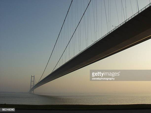 humber bridge at sunset - suspension bridge stock photos and pictures