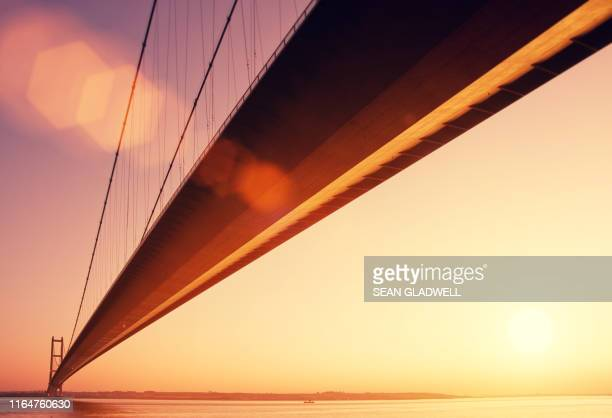 humber bridge golden hour - sunlight stock pictures, royalty-free photos & images