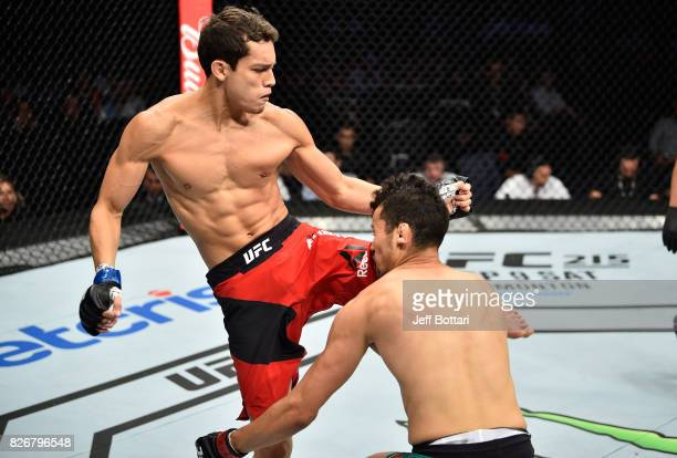 Humberto Bandenay of Peru knees Martin Bravo of Mexico in their lightweight bout during the UFC Fight Night event at Arena Ciudad de Mexico on August...
