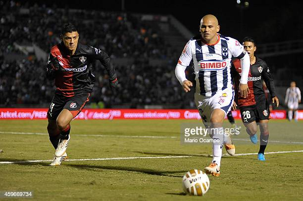 Humberto 'Chupete' Suazo of Monterrey drives the ball followed by Luis Venegas of Atlas during a quarterfinal first leg match between Monterrey and...