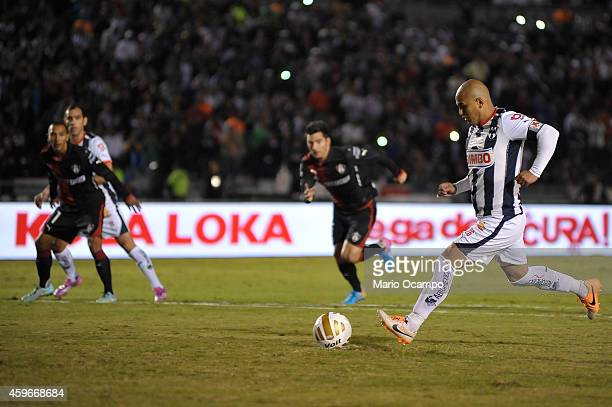 Humberto 'Chupete' Suazo of Monterrey kicks a penalty during a quarterfinal first leg match between Monterrey and Atlas as part of the Apertura 2014...
