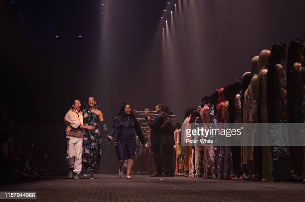 Humberto Leon, Solange Knowles and Carol Lim acknowledges the applause of the public after the Kenzo Menswear Spring Summer 2020 show as part of...