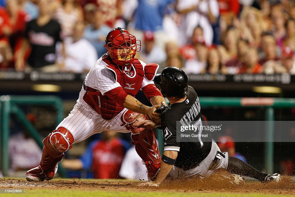 Humberto Quintero #12 of the Philadelphia Phillies tags Jeff Keppinger #7 of the Chicago White Sox out at home in the eleventh inning of the second game of a double header at Citizens Bank Park on July 13, 2013 in Philadelphia, Pennsylvania. The Phillies won 2-1 in the thirteenth inning.