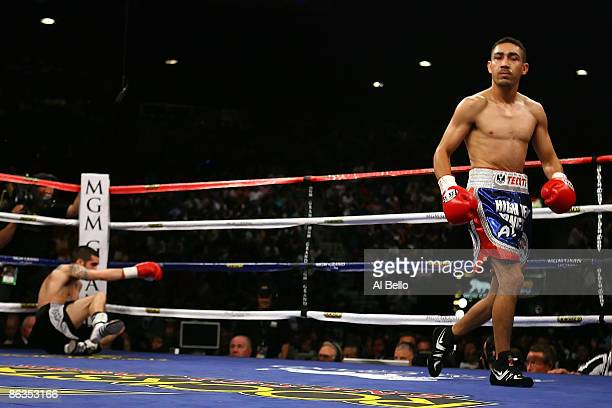 Humberto Soto of Mexico walks to his corner after knocking down Benoit Gaudet of Canada in the first round during their super featherweight title...