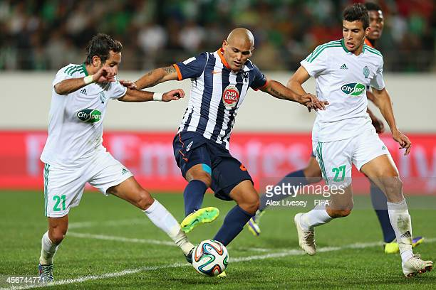 Humberto Suazo of CF Monterrey is tackled by Adil Karrouchy of Raja Casablanca during the FIFA Club World Cup Quarter Final match between Raja...