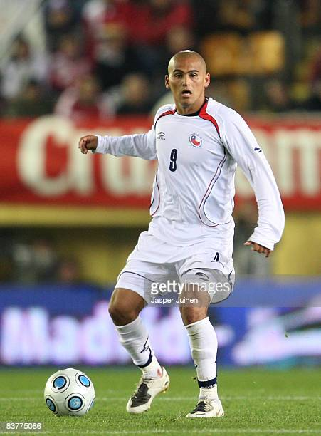 Humberto Suazo of Chile with the ball at his feet during the international friendly match between Spain and Chile at the El Madrigal stadium on...