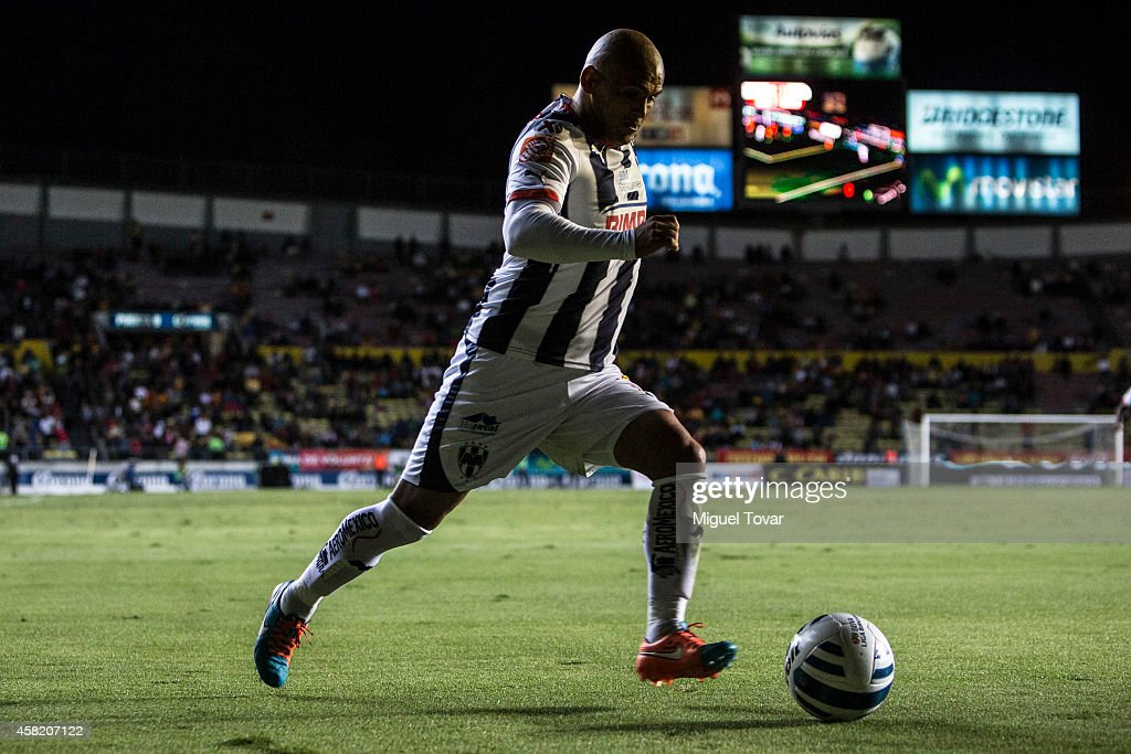 Humberto Suazo of Monterrey drives the ball during a match between Morelia and Monterrey as part of 15th round Apertura 2014 Liga MX at Jose Maria Morelos y Pavon Stadium on October 31, 2014 in Morelia, Mexico.