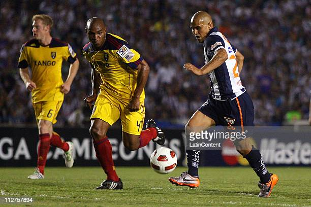 Humberto Suazo of Monterrey fights for the ball with Jamison Olave for Real Salt Lake during the first leg as part of the Champions League CONCACAF...