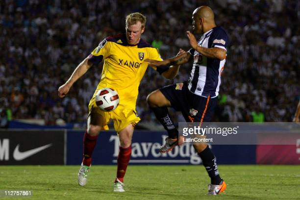 Humberto Suazo of Monterrey fights for the ball with Nat Borchers for Real Salt Lake during the first match as part of the Champions League CONCACAF...