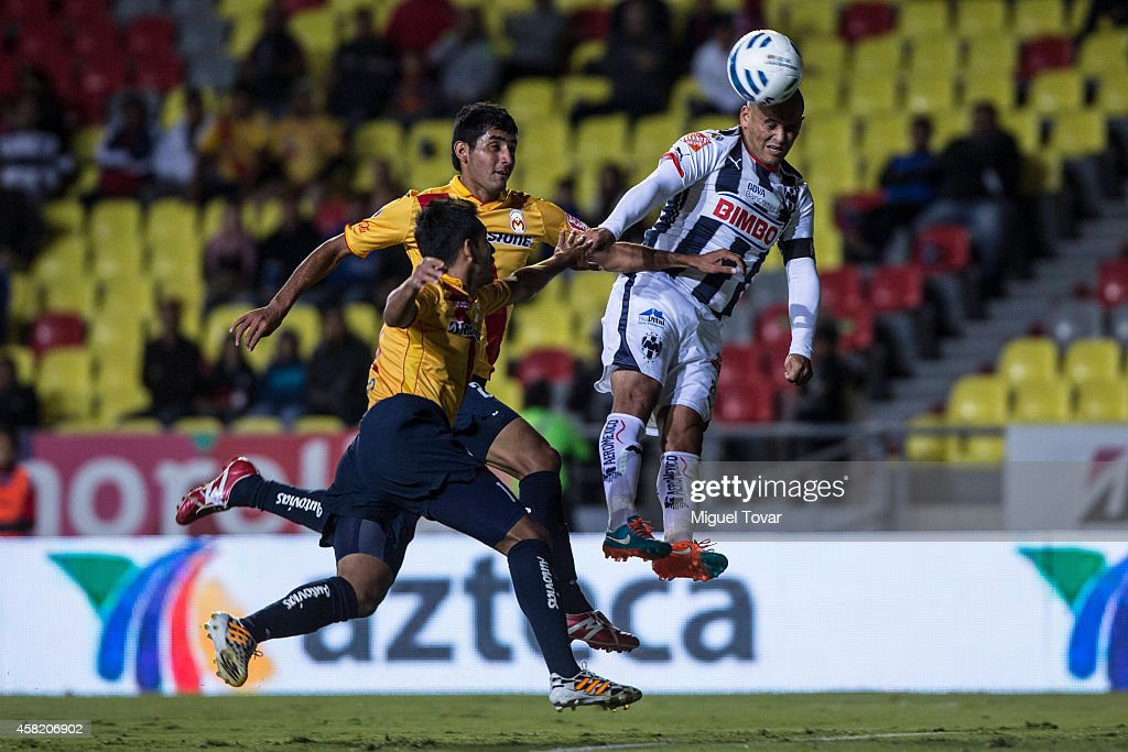 Humberto Suazo of Monterrey heads the ball during a match between Morelia and Monterrey as part of 15th round Apertura 2014 Liga MX at Jose Maria Morelos y Pavon Stadium on October 31, 2014 in Morelia, Mexico.