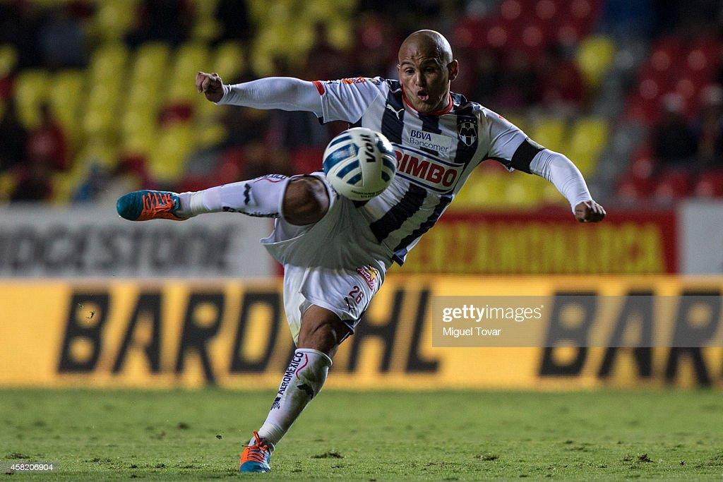 Humberto Suazo of Monterrey kicks the ball during a match between Morelia and Monterrey as part of 15th round Apertura 2014 Liga MX at Jose Maria Morelos y Pavon Stadium on October 31, 2014 in Morelia, Mexico.