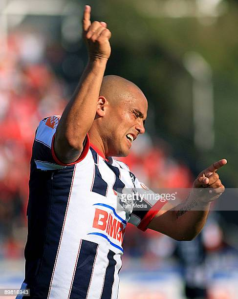 Humberto Suazo of Rayados de Monterrey celebrates after scoring against Toluca in a Mexican League Apertura 2009 soccer match at the Tecnologico...