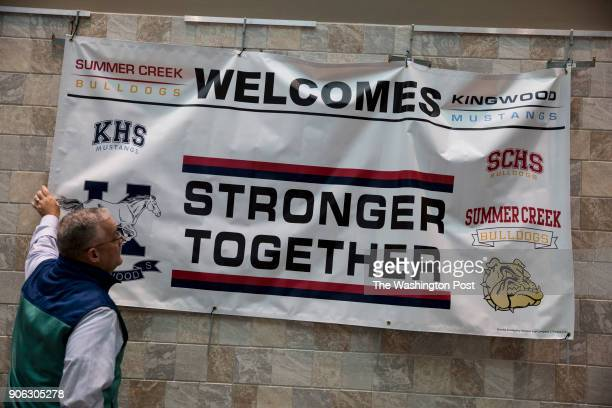 Humble ISD Assistant Superindendent Trey Kraemer straightens a sign welcoming Kingwood High School to the Summer Creek campus After Kingwood High...