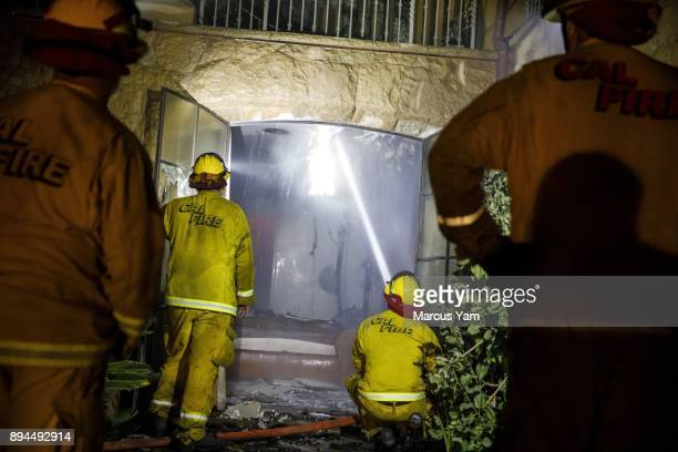 Humboldt County fire crews check for residual heat inside a home that was destroyed by the Thomas Fire in Montecito Calif on Dec 17 2017