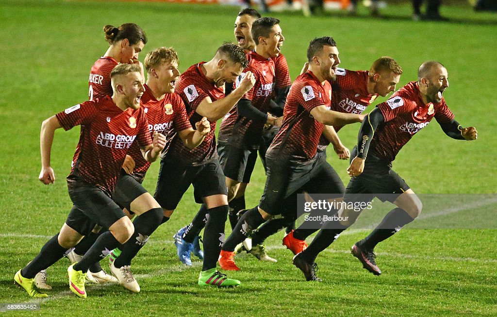 Hume City players celebrate as Shane Rexhepi of Hume City scores the final penalty goal to win the FFA Cup round of 32 match between Hume City and Marconi Stallions at ABD Stadium on July 27, 2016 in Melbourne, Australia.