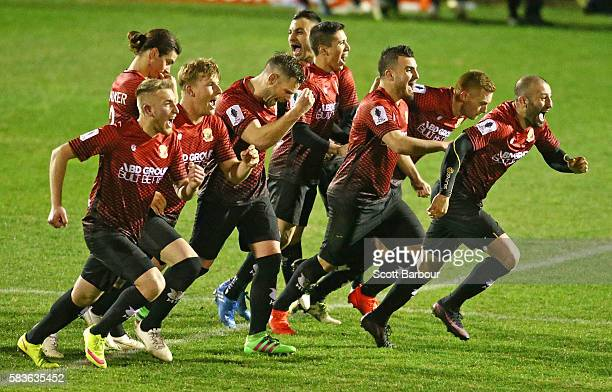 Hume City players celebrate as Shane Rexhepi of Hume City scores the final penalty goal to win the FFA Cup round of 32 match between Hume City and...