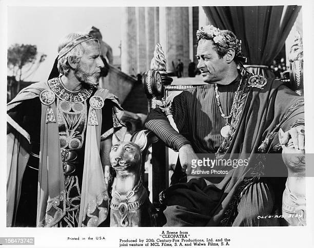 Hume Cronyn looking over at Rex Harrison in a scene from the film 'Cleopatra' 1963