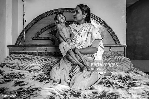 Humera 3 years old with her mother Shazia at home in the Nawab Colony neighborhood Humera was born to parents contaminated by a carcinogenic and...