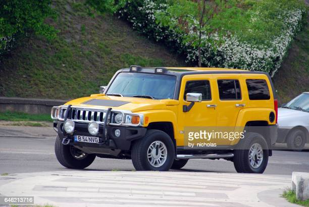 hummer h2 on the streets on galati, romania - hummer stock photos and pictures