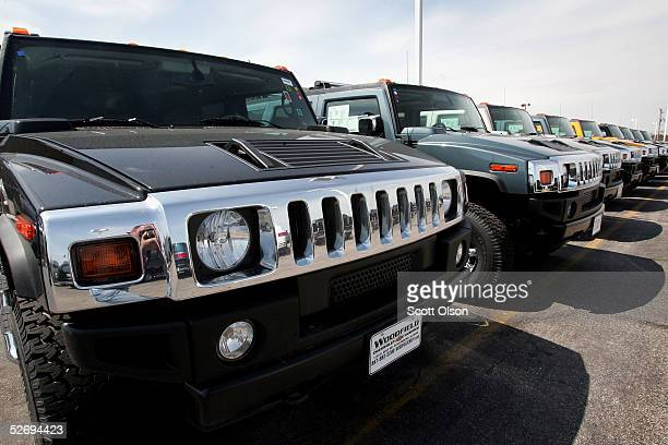 Hummer H2 sport utility vehicles sit on the lot of a suburban Chicago dealership April 25 2005 in Schaumburg Illinois General Motors announced today...