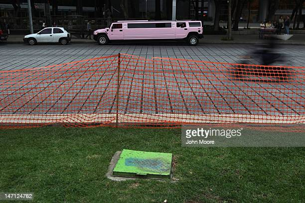 Hummer limousene awaits Mexican teenagers to return following a photo shoot at Mexico's Angel of Independence monument on June 23 2012 in Mexico City...