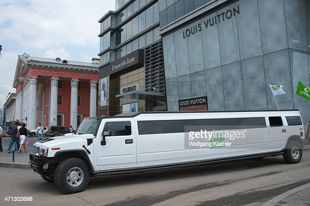 Hummer limousine in front of Central Tower in downtown Ulaanbaatar Mongolia