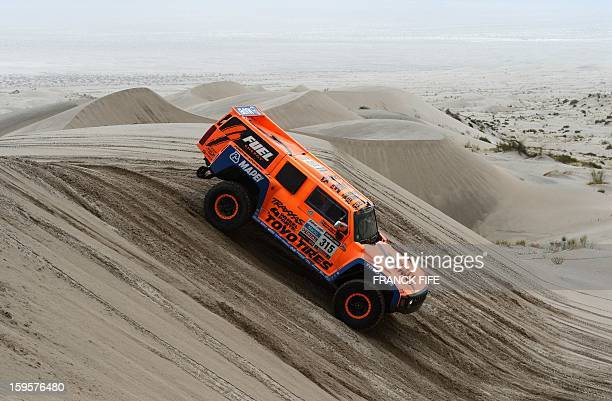 Hummer's US Robbie Gordon competes during the Stage 11 of the Dakar 2013 between La Rioja and Fiambala Argentina on January 16 2013 The rally takes...
