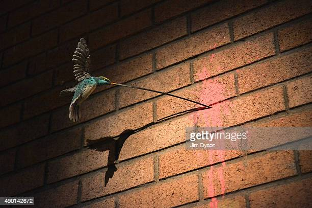 A hummingbird sculpture by Banksy during the final weekend closing party of Dismaland on September 25 2015 in WestonSuperMare England Graffiti artist...