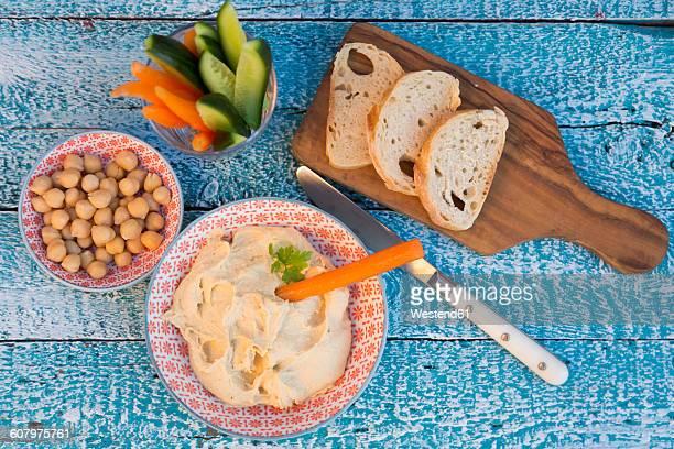 Hummus, chick peas, carrots, cucumber, baguette