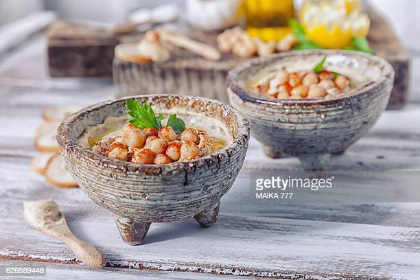 Hummus topped with whole chickpeas and olive oil.