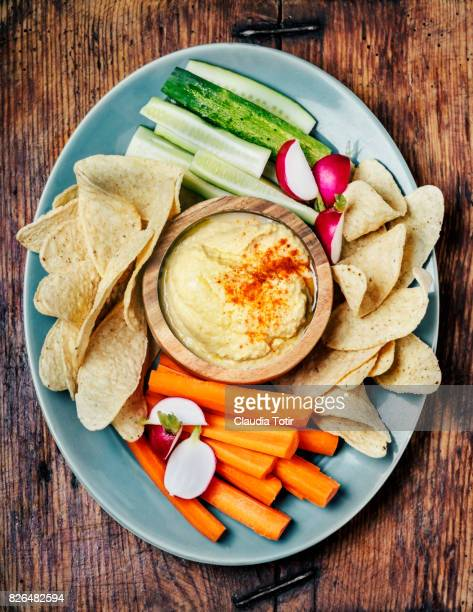 Hummus with vegetables and tortilla chips