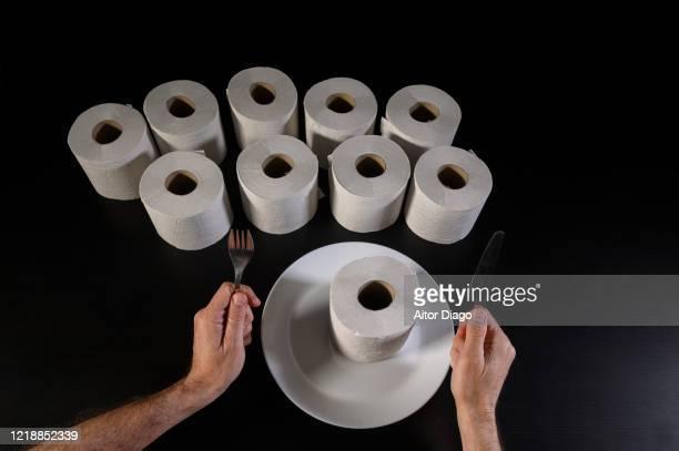 humor. a man is ready to eat a roll paper! - hemorroide fotografías e imágenes de stock