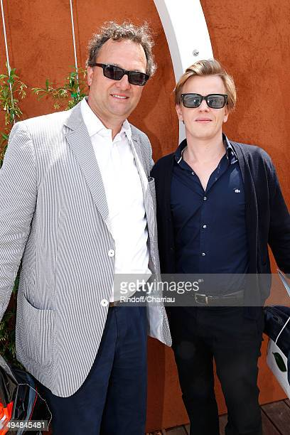 Humorist Alex Lutz and his father in law Dominique Hummel attend the Roland Garros French Tennis Open 2014 Day 7 on May 31 2014 in Paris France