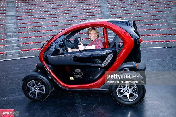 Humorist Alex Lutz Show poses in an Electric Renault Car on stage before his show during the 31th Ramatuelle Festival Day 8 on August 8 2015 in...