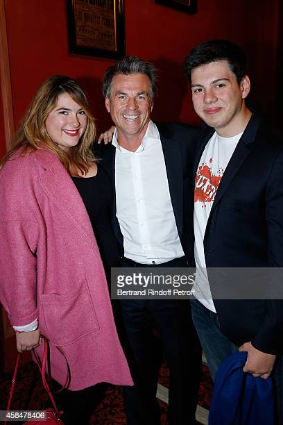 Humorist Bruno Gaccio standing between his children Charlotte Gaccio and Enzo Gaccio attend the 150th Representation of the 'Je prefere qu'on reste...