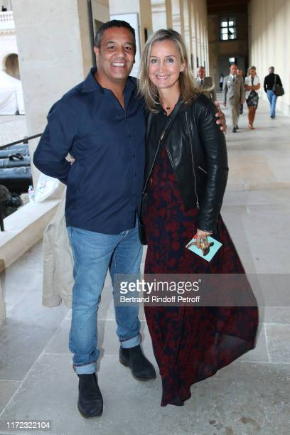 Humorist Cartouche and actress Catherine Marchal attend the Tosca Opera en Plein Air performance at Les Invalides on September 04 2019 in Paris France