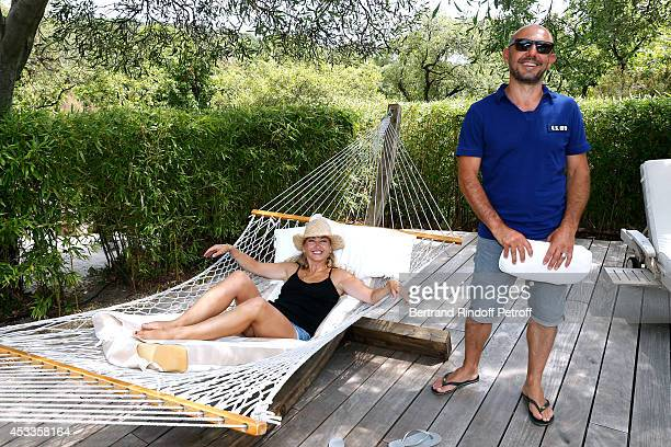 Humorist Christelle Chollet and her husband producer and scenarist Remy Caccia attend the lunch at Jacqueline Franjou's house as part of the 30th...