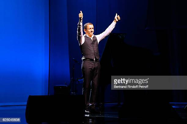 Humorist Dany Boon acknowledges the applause of the audience at the end of his Dany De Boon Des HautsDeFrance Show at L'Olympia on November 12 2016...