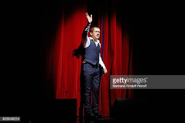 Humorist Dany Boon acknowledges the applause of the audience at the end of his Dany De Boon Des HautsDeFrance Show at L'Olympia on November 13 2016...