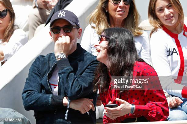 Humorist Gad Elmaleh and Sasha Spielberg attend the 2019 French Tennis Open Day Fifteen at Roland Garros on June 09 2019 in Paris France
