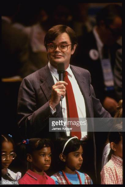 Humorist Garrison Keillor addressing Democratic Natl Convention standing behind row of children sitting in audience